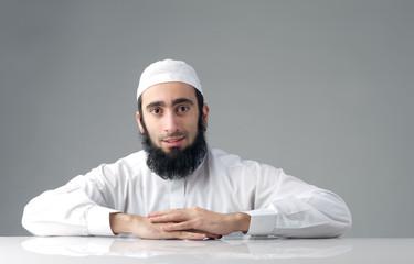 Arabic Muslim man with beard smiling