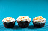 Three muffins with vanilla and sweet sugar topping