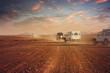 Zdjęcia na płótnie, fototapety, obrazy : Cars in the desert at sunset