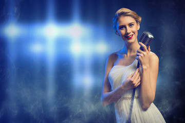 attractive female singer with microphone