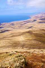 coastline lanzarote view from the top  and house field