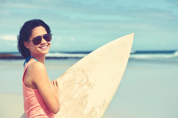 smiling female surfer