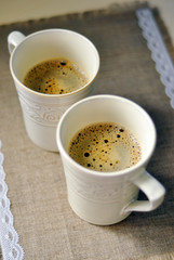 Two mugs of aromatic coffee