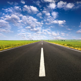 Fototapety Driving on asphalt road at nice sunny day