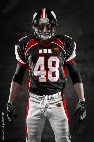 Fototapeta Portrait of american football player looking at camera