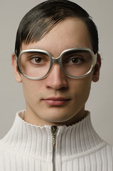 Beautiful man wearing eyeglasses and looking like a geek