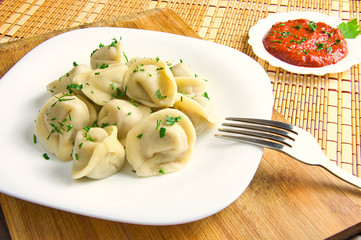 dumplings on a plate and tomato sauce