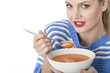 Young Woman Eating Tomato Soup