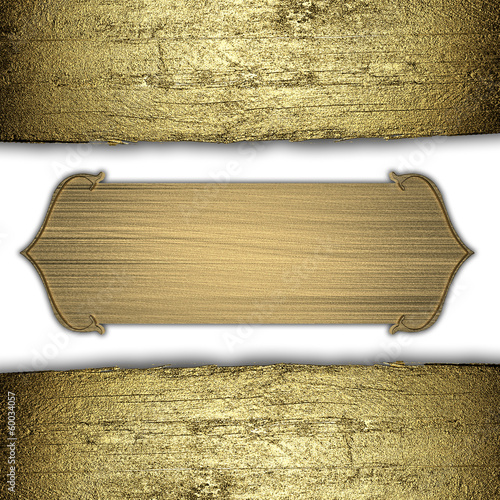 Old wooden background with gold edges and gold plate