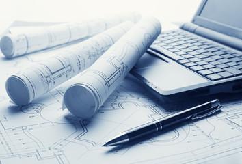 Blueprints and laptop