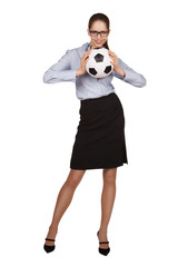 Woman holding a soccer ball with two hands
