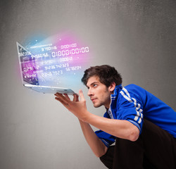 Casual man holding laptop with exploding data and numbers