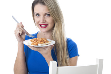 Young Woman Eating Baked Beans on Toast