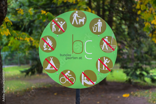 Sign on a park, with no littering, no ride bikes and no dogs