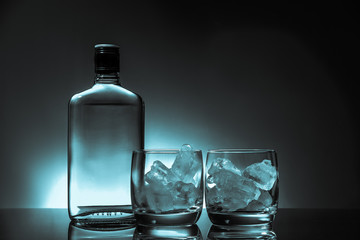 Glass and bottle of hard liquor like scotch, bourbon, whiskey or