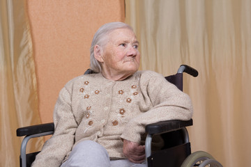 Eighty year old woman sitting in a wheelchair