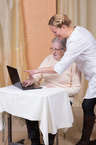 Elderly woman using a laptop compute