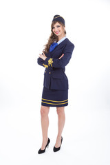 Beautiful air hostess with arms crossed