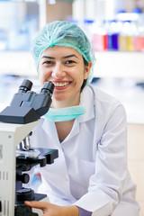 Happy female laboratory technician.