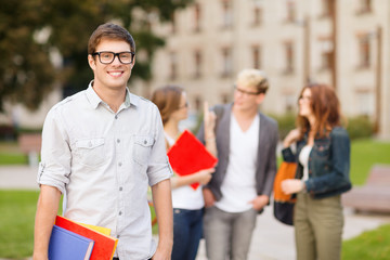 teenage boy with classmates on the back