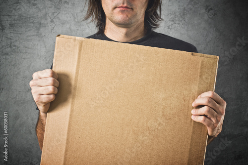 Man holding cardboard paper