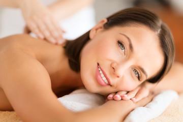 beautiful woman in spa salon getting massage