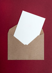 brown envelope on a red background