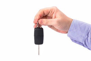 Hand with car key isolated on white background