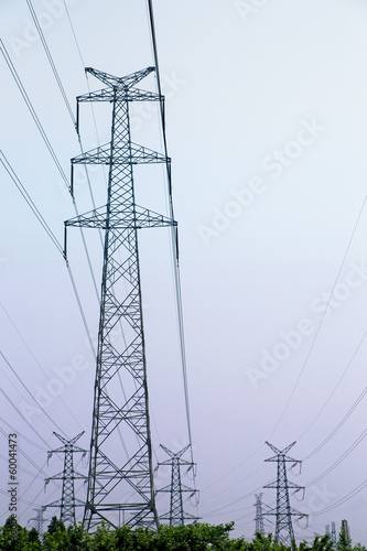 Power lines on purple sky