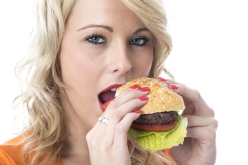 Young Woman Eating a Beef Burger