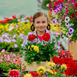 Gardening, girl holding flowers in garden center.