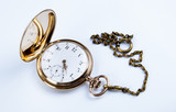 Gold pocket watch on white