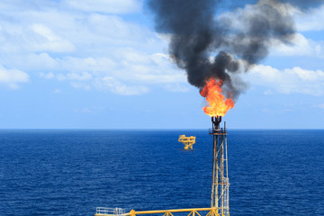 Hot flare boom and fire on offshore production platform