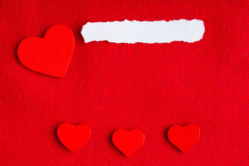 Paper blank copyspace hearts on red fabric textile material