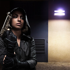Danger woman with gun