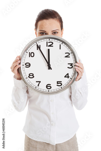 Young beautiful business woman holding clock.