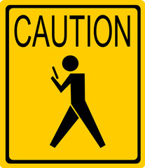 caution person texting street sign