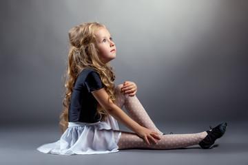 Image of curly blonde dancer sitting in studio