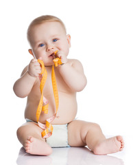 Adorable Baby Boy with a measuring tape on white background