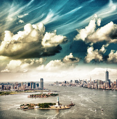 Beautiful sky over New York. Statue of Liberty, Manhattan and Je