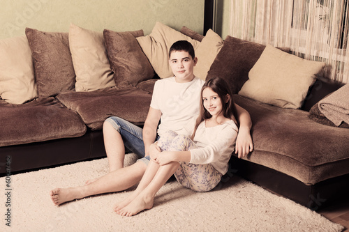 Teenage boy and girl at home