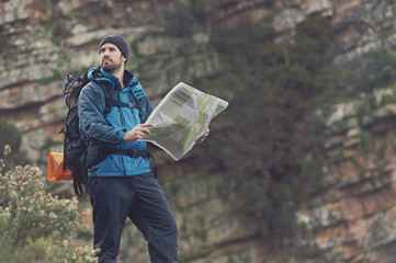 outdoor hiking man with map
