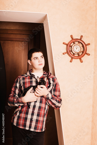 teenager with dog indoor