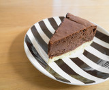 Chocolate cheesecake on a strip plate.