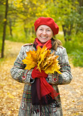 laughing mature woman  in autumn