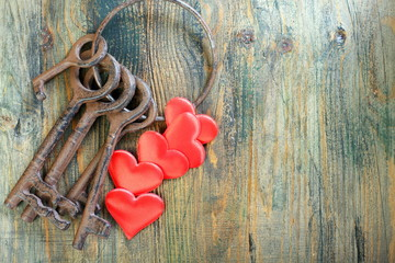Old keys and a red heart.