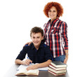 Mother standing near son's desk with hand on his shoulder