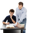 Father standing near son's desk helping him doing his homework