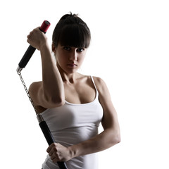 sport karate girl doing exercise with nunchaku, fitness woman si