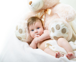 cute funny infant baby boy with big toy bear, beautiful kid's po